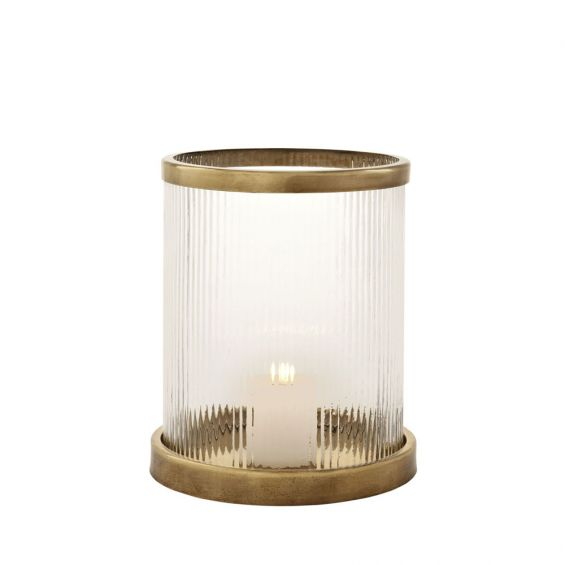 An elegant ribbed candle holder with an antique brass base and rim
