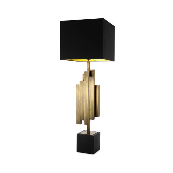 A stylish antique brass and black table lamp