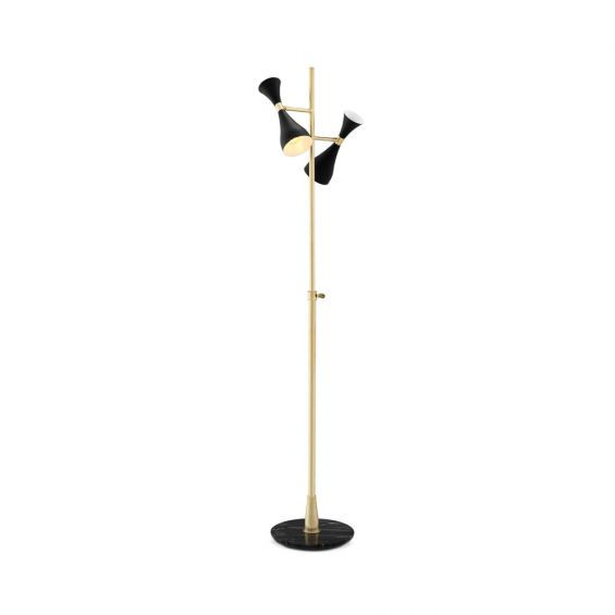 A stunning black and polished brass floor lamp with a marble base