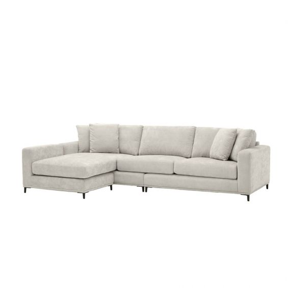 sand coloured L shaped sofa with black legs and four scatter cushions