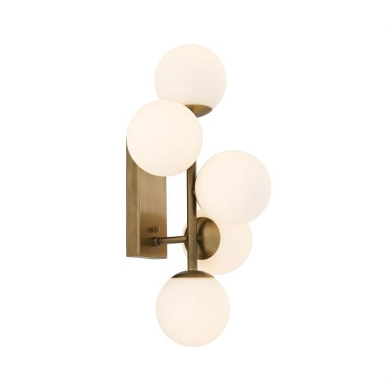 A stylish antique brass wall lamp with white glass shades