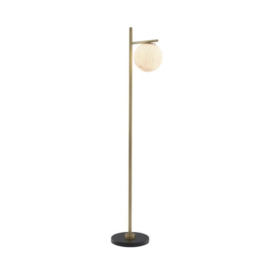 Luxurious antique brass floor lamp with alabaster lampshade on a black marble base