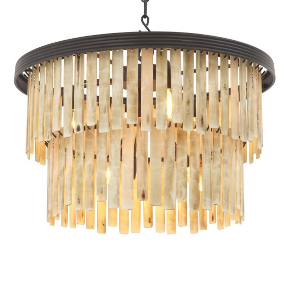 A glamorous faux bone droplet chandelier with bronze accents by Eichholtz