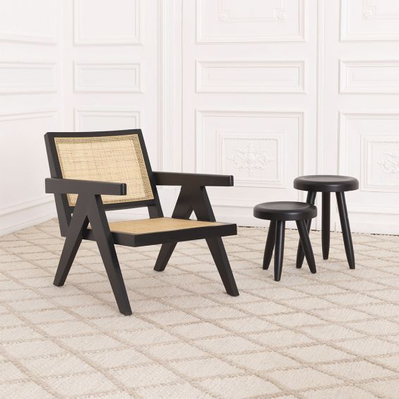 Rattan webbed, seated chair with black V-shaped legs