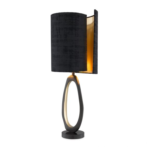 A modern luxury table lamp with black and brass accents by Eichholtz