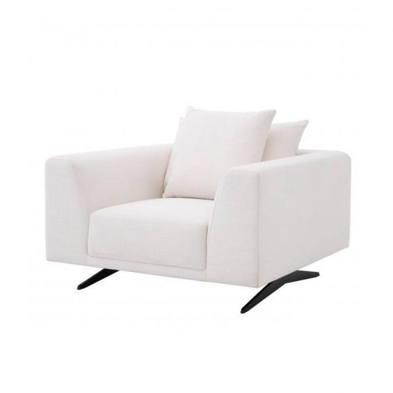 A luxurious contemporary armchair with white upholstery and contrasting black legs