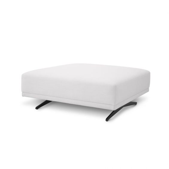 A luxurious, upholstered ottoman with white fabric and black feet