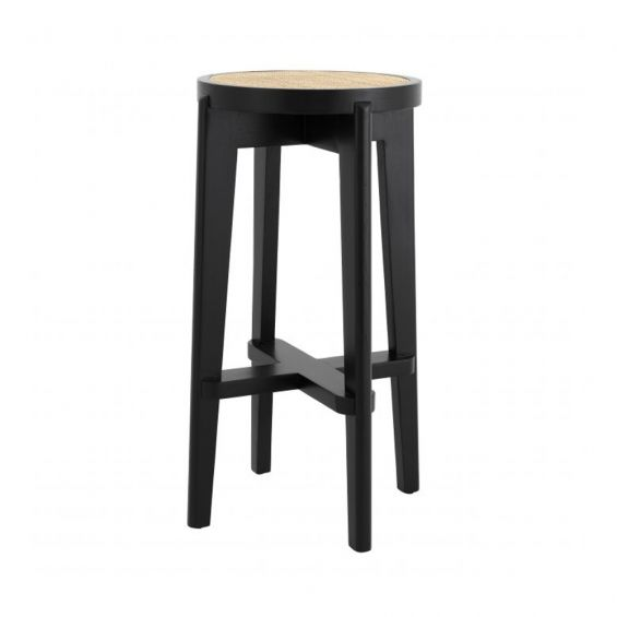 A chic black Scandinavian-inspired bar stool with rattan cane webbing