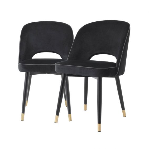 Set of 2 black velvet dining chairs with faux leather piping and golden detailing