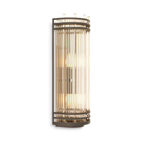 An elegant bronze and clear glass wall lamp