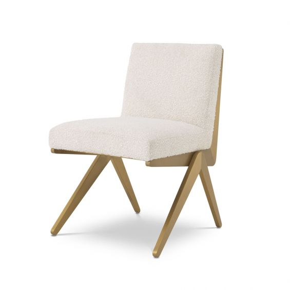 a luxurious boucle and brushed brass dining chair