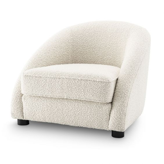 Luxurious boucle cream armchair with sloped arms by Eichholtz