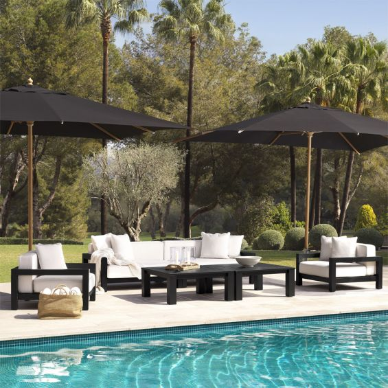 A luxurious outdoor sofa with a black-toned frame and natural-coloured upholstery