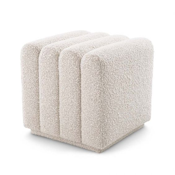 A boucle cream stool with deep channel stitching fit for any modern decor