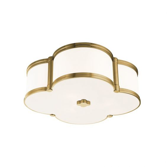 A luxurious aged brass and white glass ceiling lamp