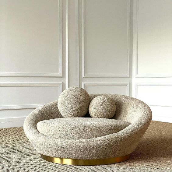 A sumptuous Canberra sand sofa with a brushed brass base
