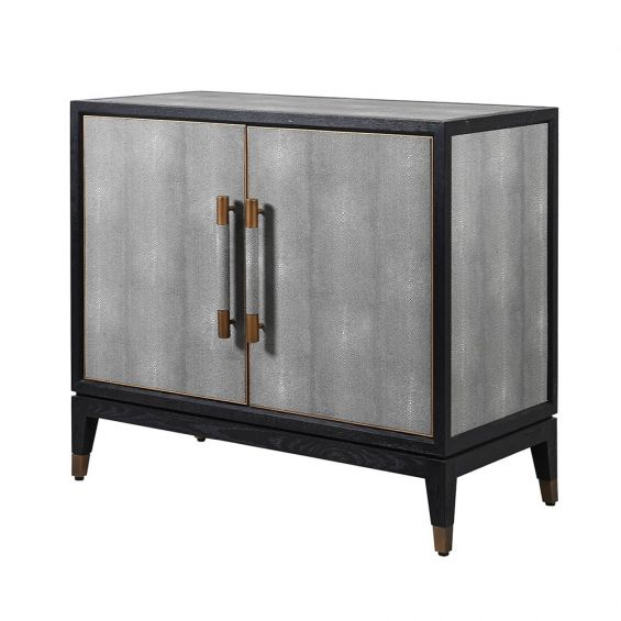 A luxurious small grey faux shagreen cabinet with black and brass accents