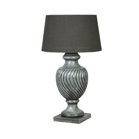 A luxurious table lamp with distressed finish and shade