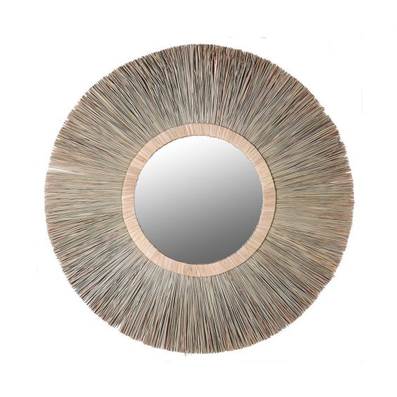 A stunning, round mirror with a natural wicker structure