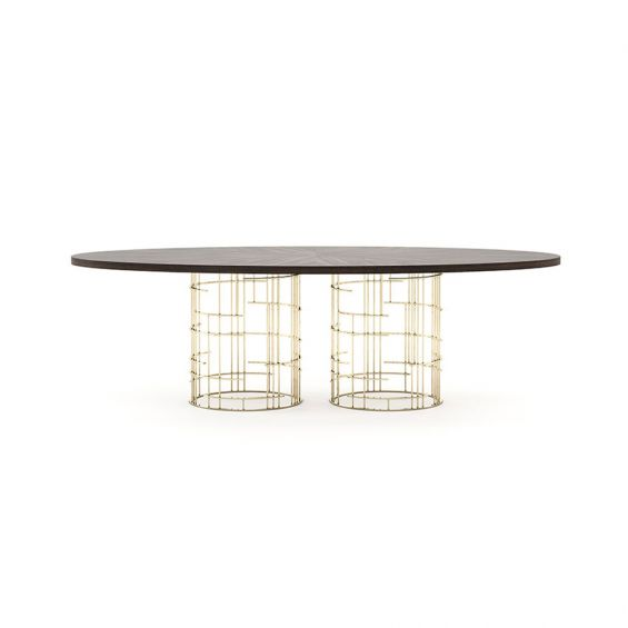 A luxury dining table with an asymmetrical golden base