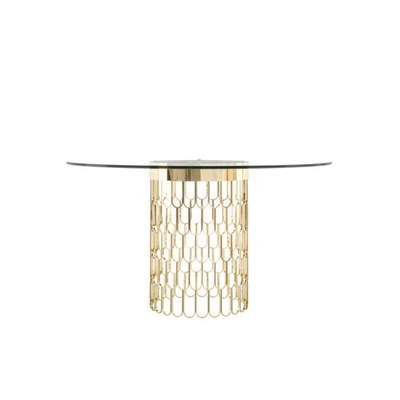 A modern dining table with an art deco-inspired golden base and round glass tabletop