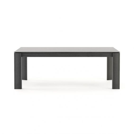 A luxurious, sculptural extendable dining table in a matte grey eucalyptus finish