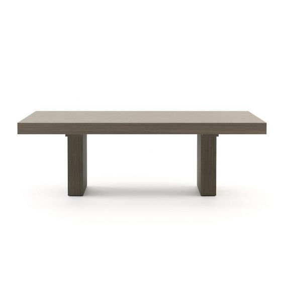 A luxurious minimal dining table in a grey eucalyptus finish