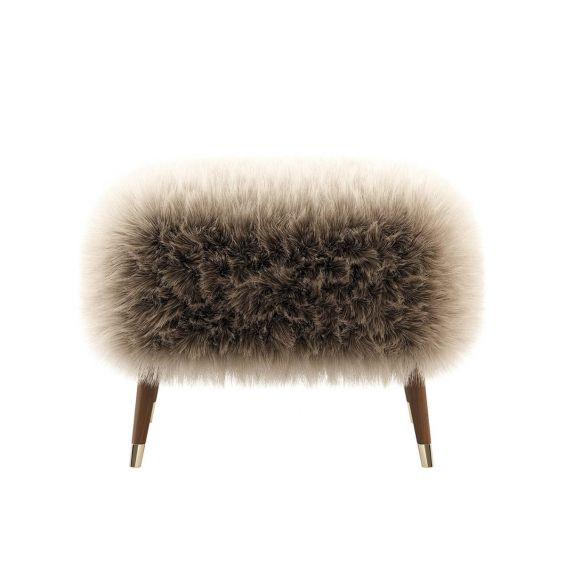 A luxuriously fluffy stool with wooden legs and golden caps