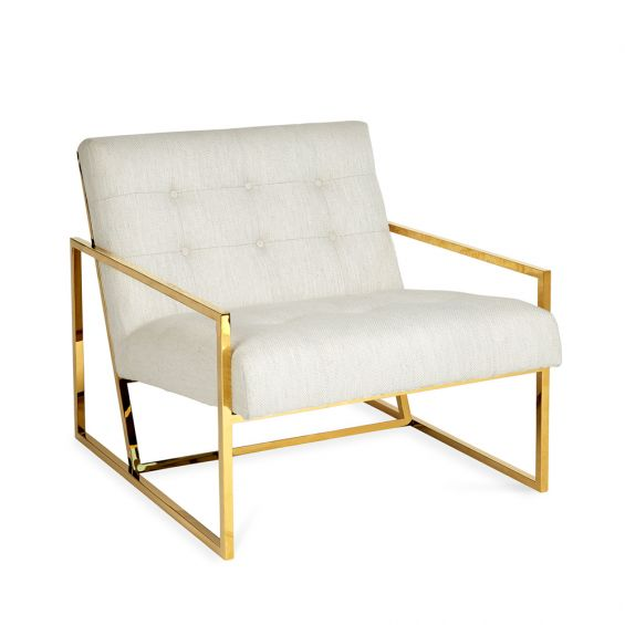 a modern linen armchair with polished brass frame
