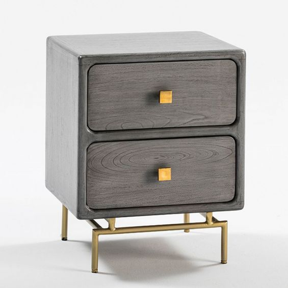 A luxurious greyed wood and golden metal two drawer bedside table