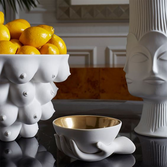 A luxurious hand-shaped bowl with gold interior detailing