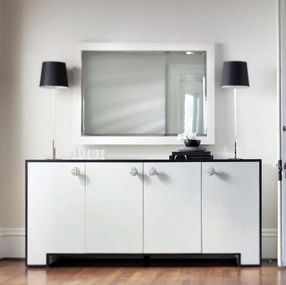Monochromatic sideboard with four doors and rose detail handles