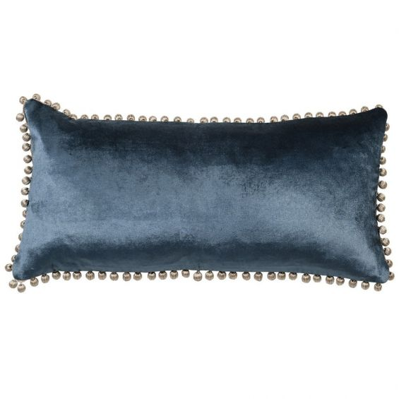 A luxurious blue velvet cushion with silver bobbles