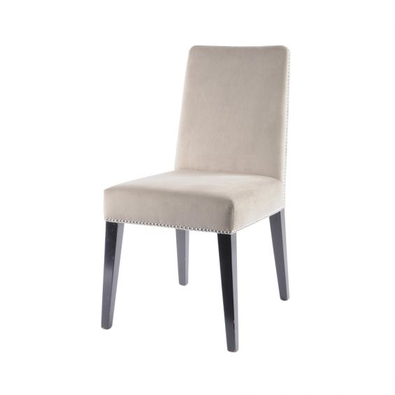 taupe velvet dining chair with silver details and dark brown legs