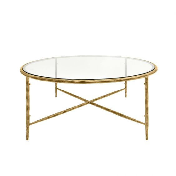 A luxurious round wood or metal coffee table with a clear glass surface