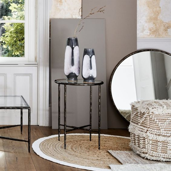 A luxurious hand forged side table in wood, brass, bronze and nickel finishes with clear table tops