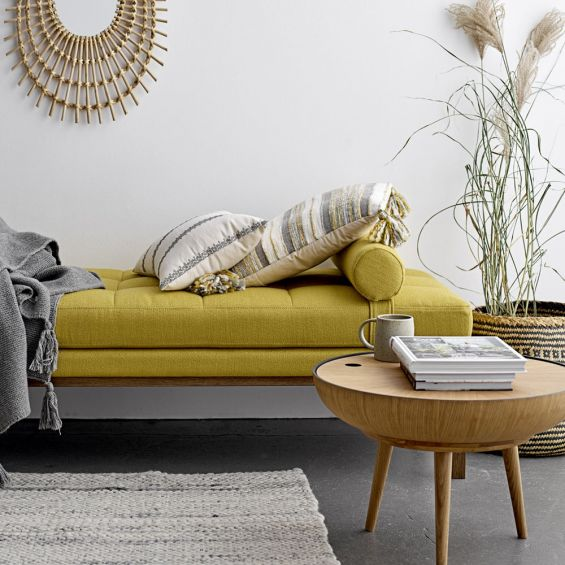 A gorgeous Nordic-inspired round oak coffee table with a removable top