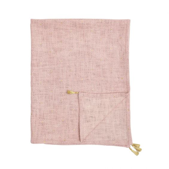 A luxurious pink cotton throw with golden tassels