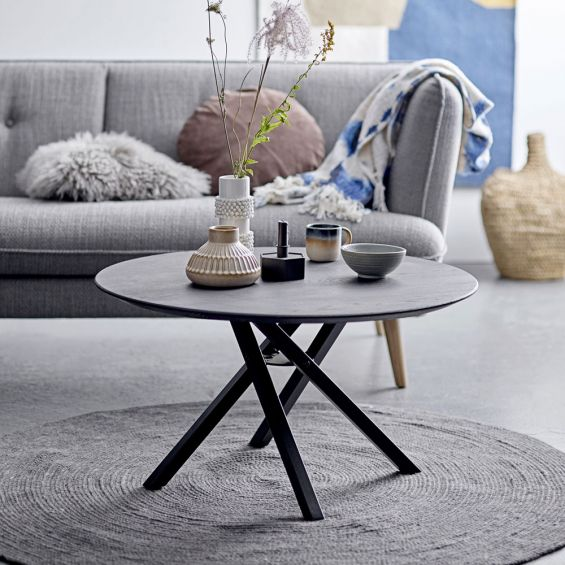 a luxurious black oak coffee table with metal legs