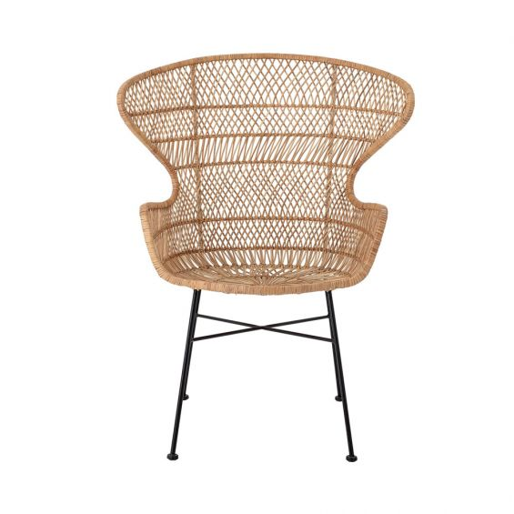 A luxurious woven rattan armchair with metal legs
