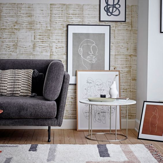 A modern white marble coffee table with a stainless steel frame