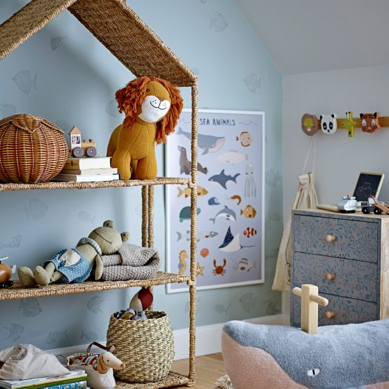 A luxurious natural woven house-shaped kids bookcase