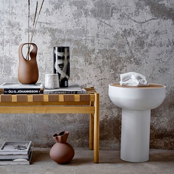 A luxurious white and natural wood side table with an oak veneer top
