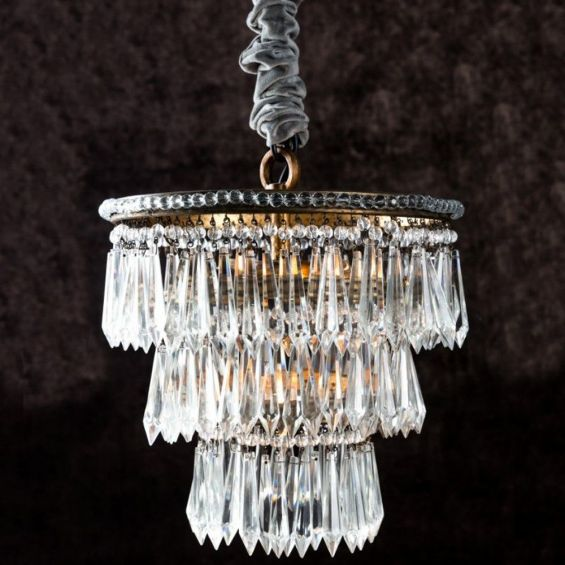 Antique gold chandelier with hanging beads and glass crystals
