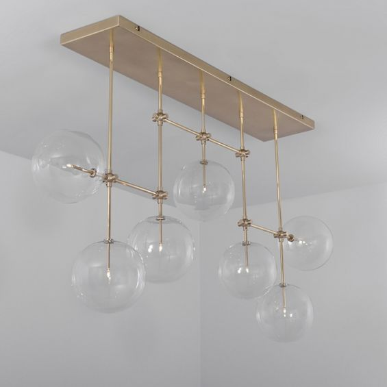 Natural brass finish industrial style chandelier with hanging clear glass globes
