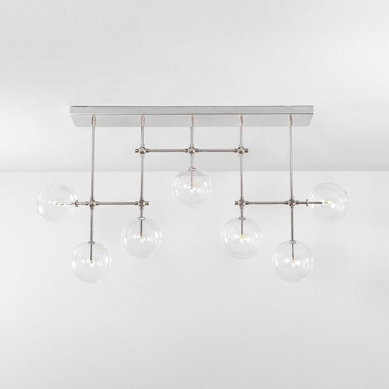 Polished nickel industrial sleek chandelier with hanging clear glass globe design