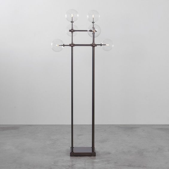 Black gunmetal finish industrial style floor lamp with clear glass globe design