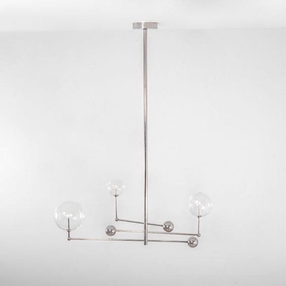 Polished nickel retro chandelier with rotational arms and clear glass globe lampshades