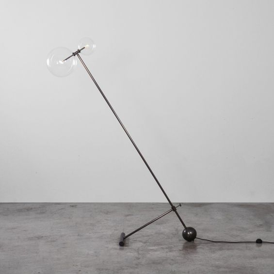 Black gunmetal brass industrial style floor lamp with angled, adjustable frame and clear glass globe lampshades