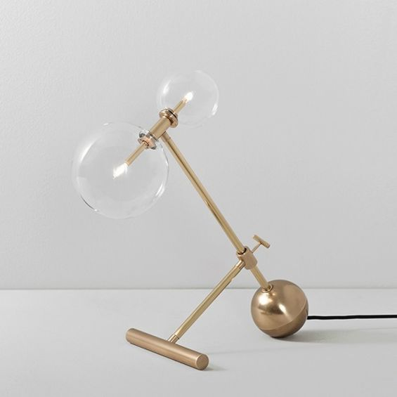 Industrial style table lamp in a natural brass finish with clear glass lampshade design